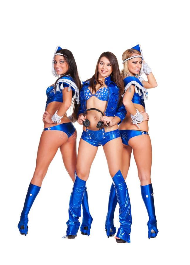 Meninas 'sexy' do smiley no traje azul do estágio fotografia de stock royalty free