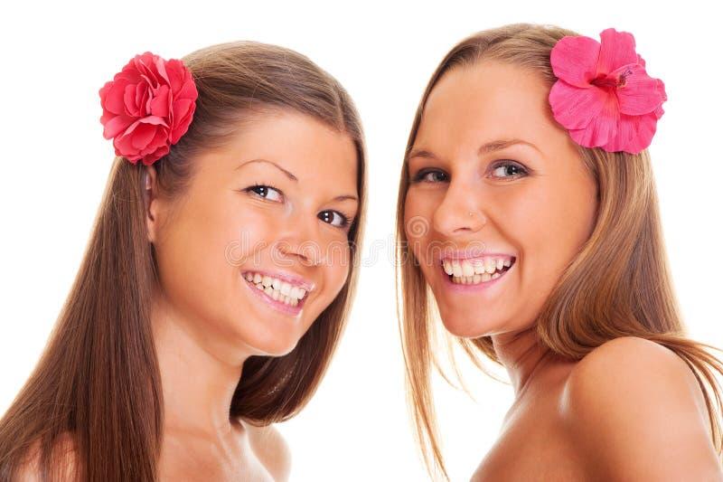 Meninas tanned felizes fotografia de stock