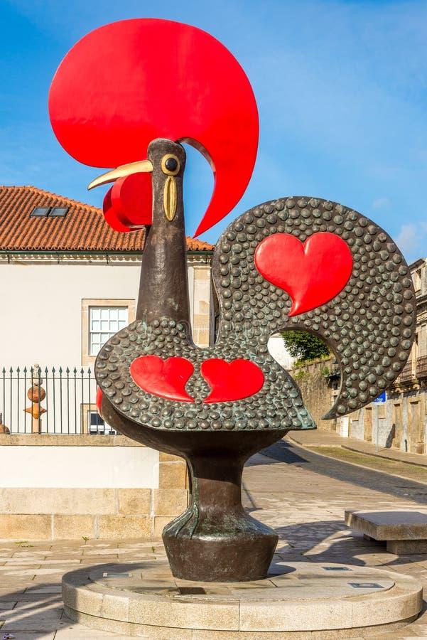 Mening bij de Haan van het Stadssymbool van Barcelos in Portugal stock foto's