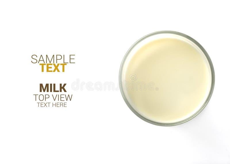 Mening en de tekst van het melkglas de hoogste op witte geïsoleerde achtergrond, stock afbeeldingen