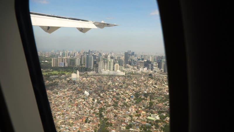 Mening van een vliegtuigvenster Manilla, Filippijnen royalty-vrije stock foto