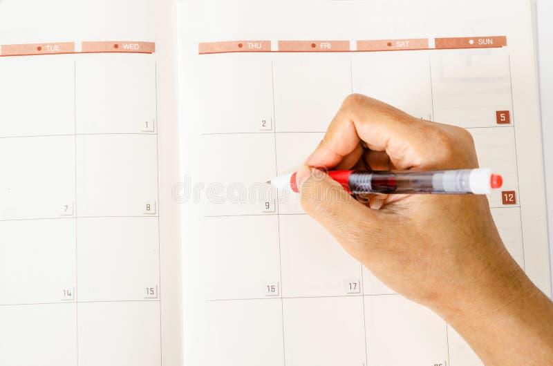Mening van maand planning in de kalender stock fotografie