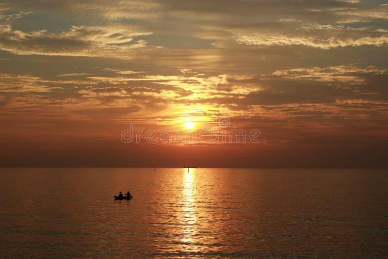 Meningszeegezicht in zonsondergangtijd stock afbeelding