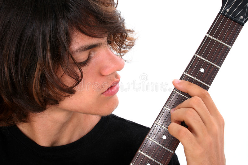 Menino adolescente com guitarra elétrica fotografia de stock