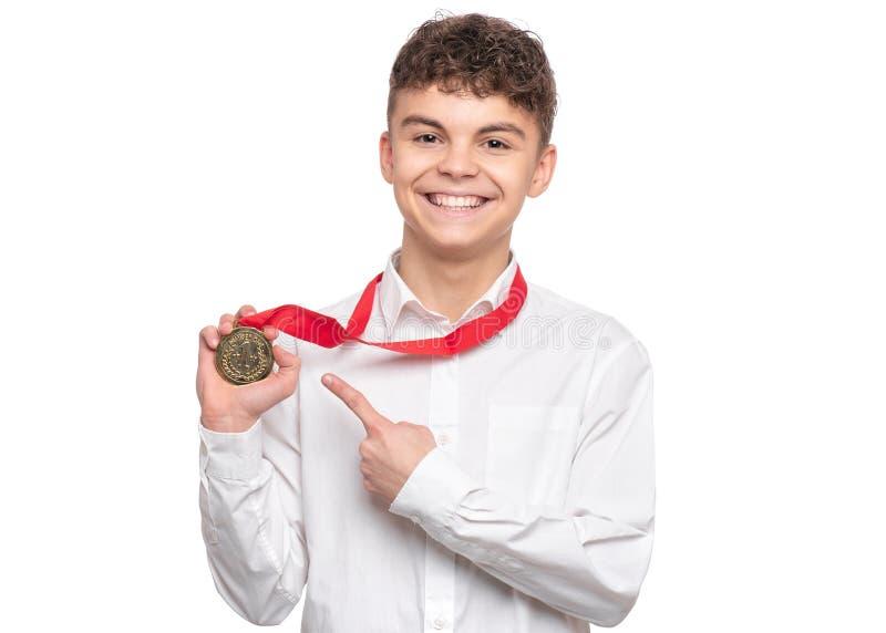 Menino adolescente com medalha fotografia de stock