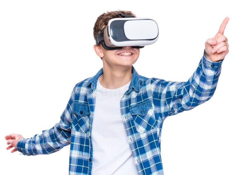 Menino adolescente em vidros de VR fotografia de stock royalty free
