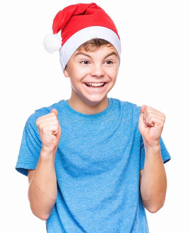 Menino adolescente que veste o chapéu de Santa Claus fotos de stock royalty free