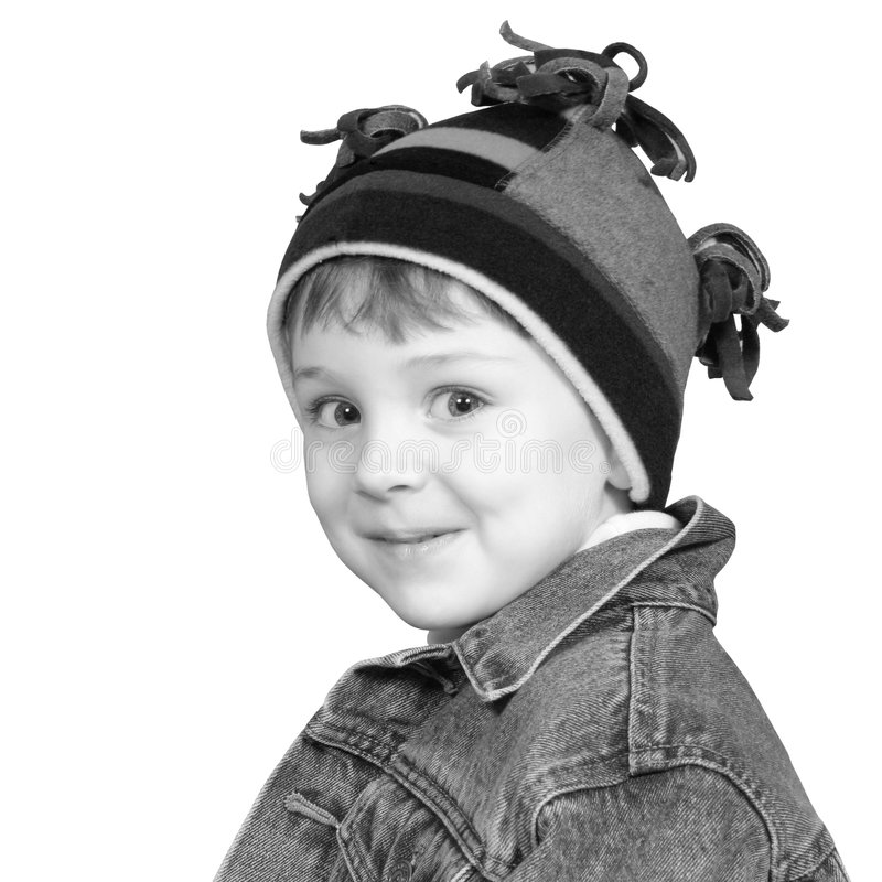 Menino adorável no chapéu do inverno em preto e branco imagem de stock royalty free