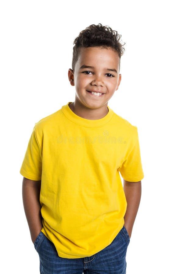 Menino africano adorável no fundo do branco do estúdio fotografia de stock royalty free