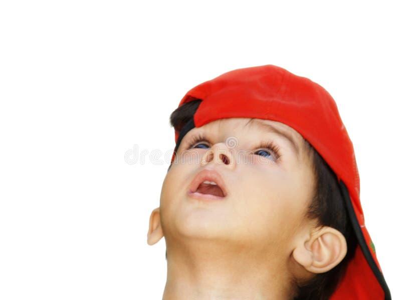 Menino asiático com chapéu vermelho fotografia de stock royalty free