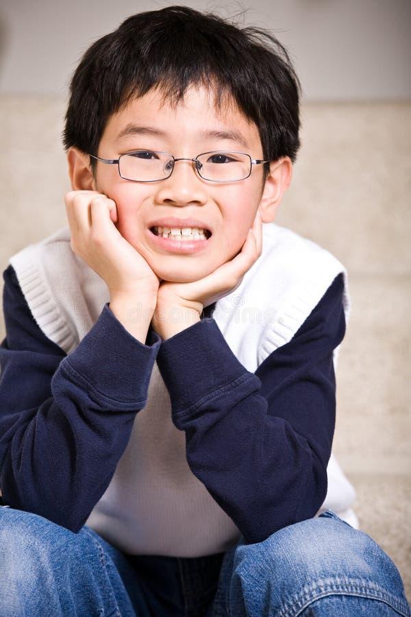 Menino asiático feliz foto de stock