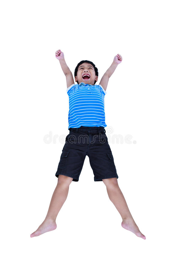 Menino asiático feliz que sorri e que salta, isolado no backgroun branco fotografia de stock royalty free