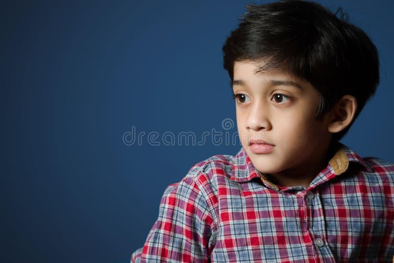 Menino asiático na camisa da verificação imagens de stock
