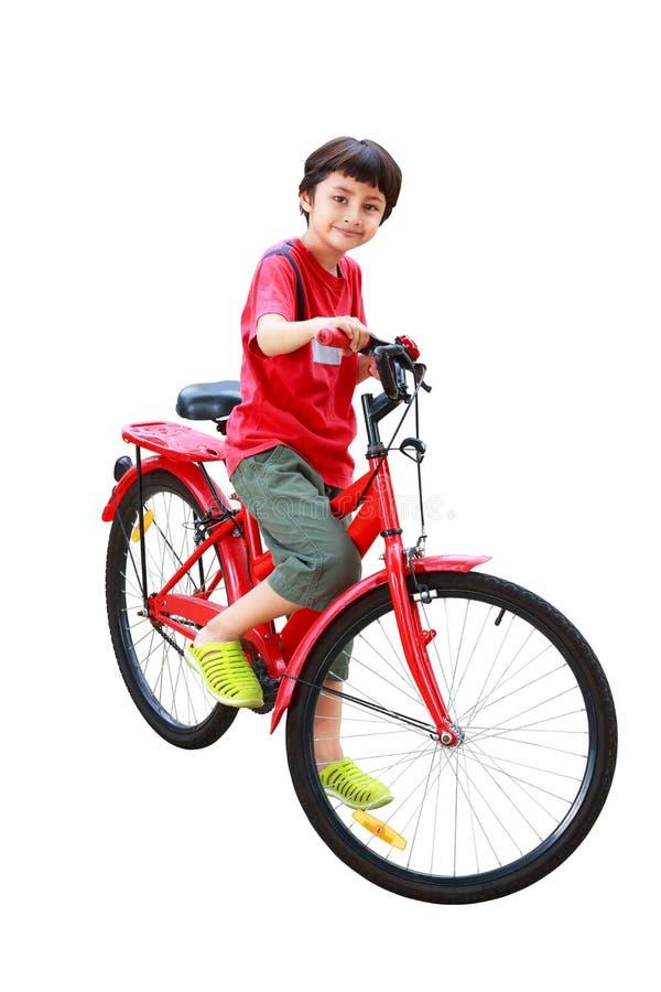 Menino asiático novo na bicicleta fotografia de stock