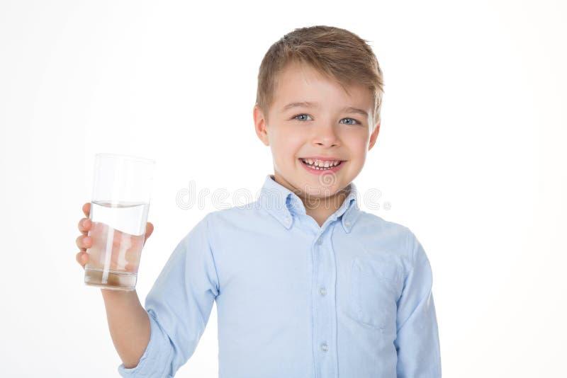 Menino bonito com água fotografia de stock royalty free