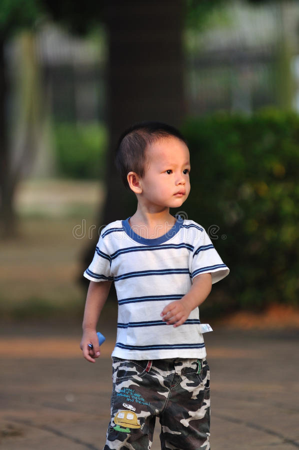 Menino chinês foto de stock