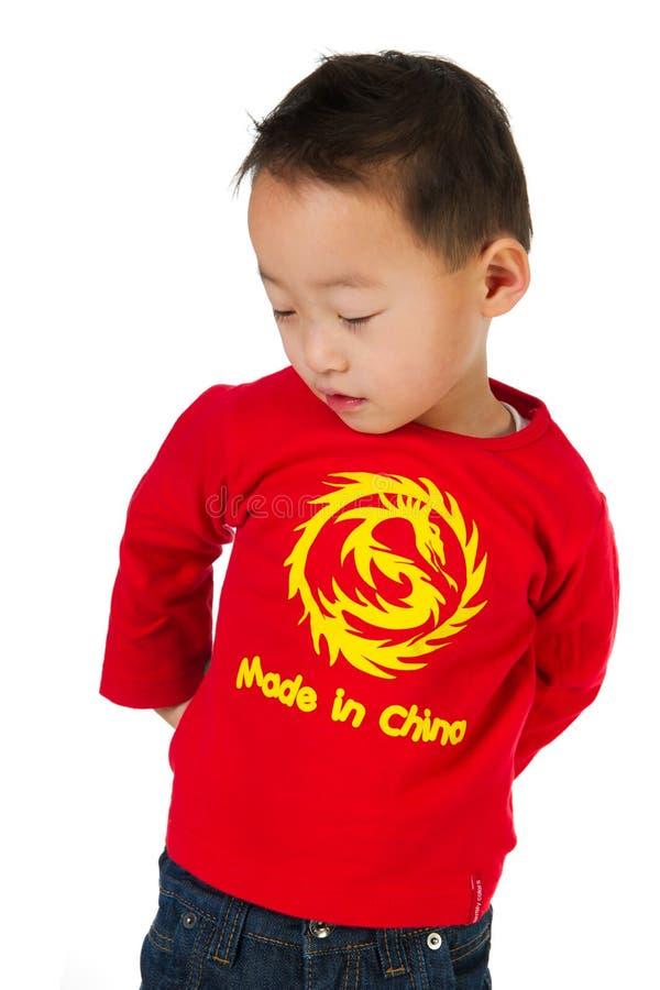 Menino chinês tímido imagem de stock