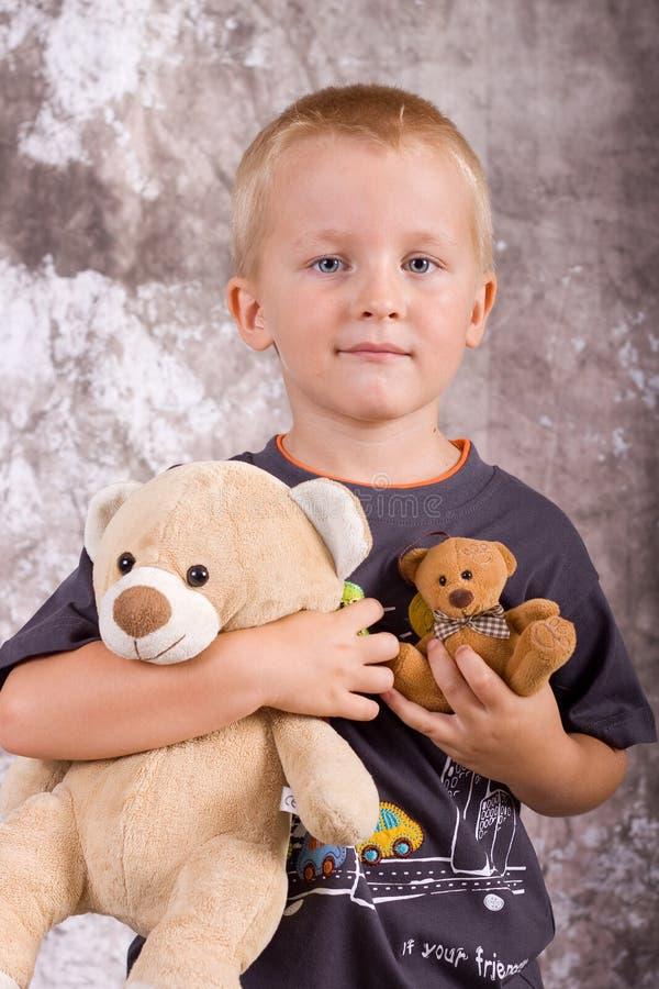 Menino com brinquedos imagens de stock royalty free