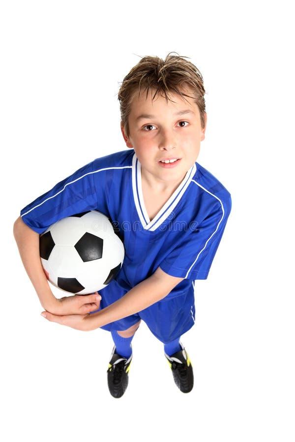 Menino com esfera de futebol imagens de stock royalty free
