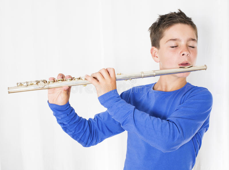 Menino com flauta imagens de stock royalty free