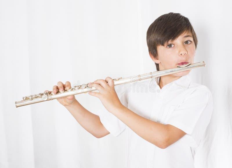 Menino com flauta imagem de stock royalty free