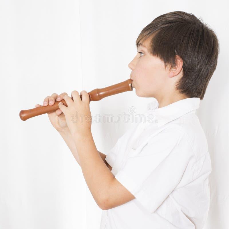Menino com flauta fotografia de stock