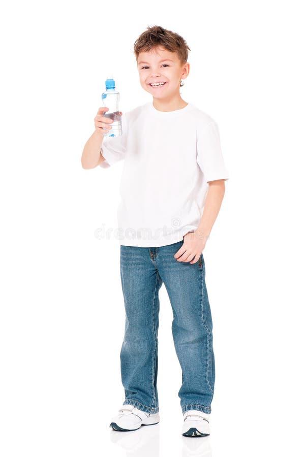 Menino com a garrafa da água imagens de stock royalty free