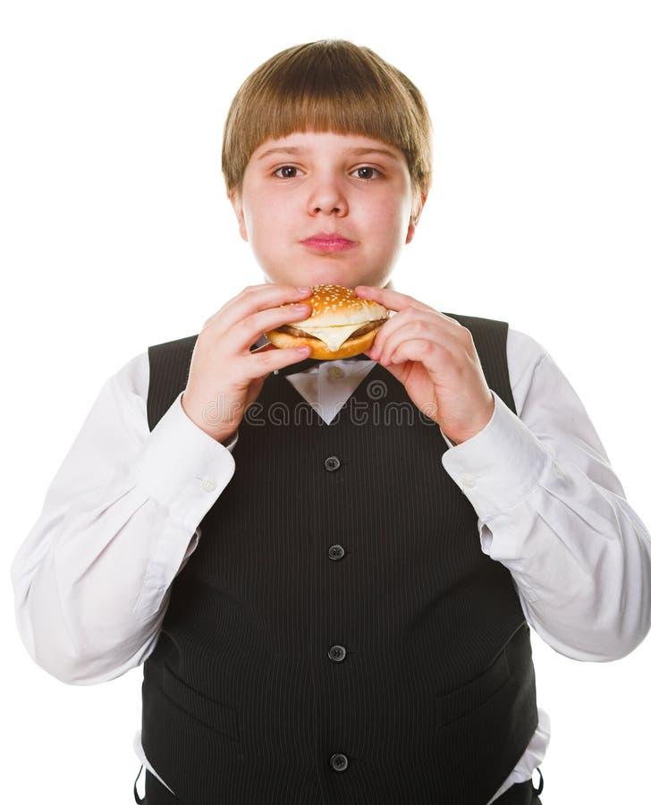 Menino com hamburguer imagens de stock