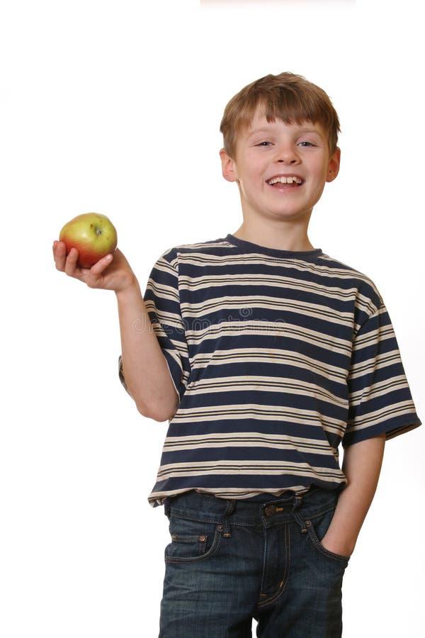 Menino com maçã imagem de stock royalty free