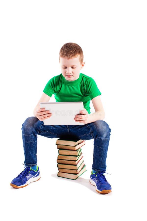 Menino com portátil e livros fotografia de stock royalty free