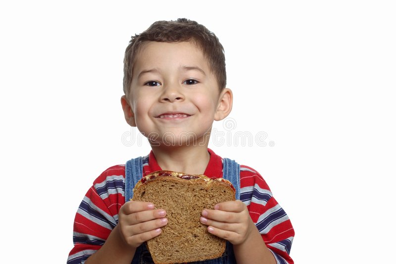 Menino com sanduíche imagens de stock