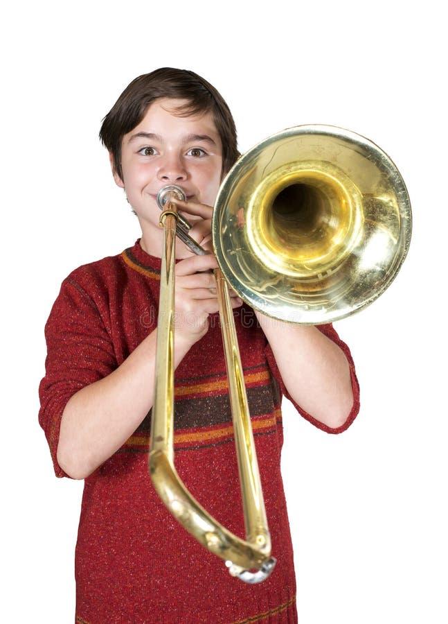 Menino com um trombone fotografia de stock