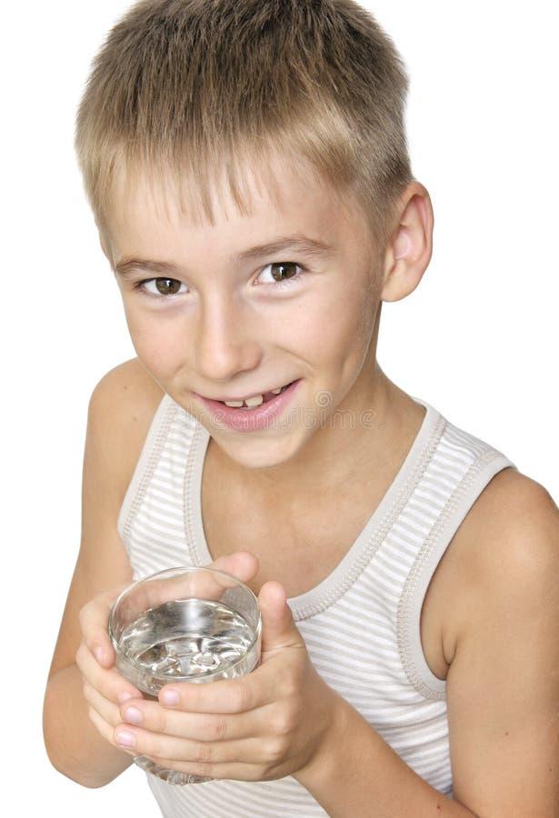 Menino com vidro da água fotografia de stock royalty free