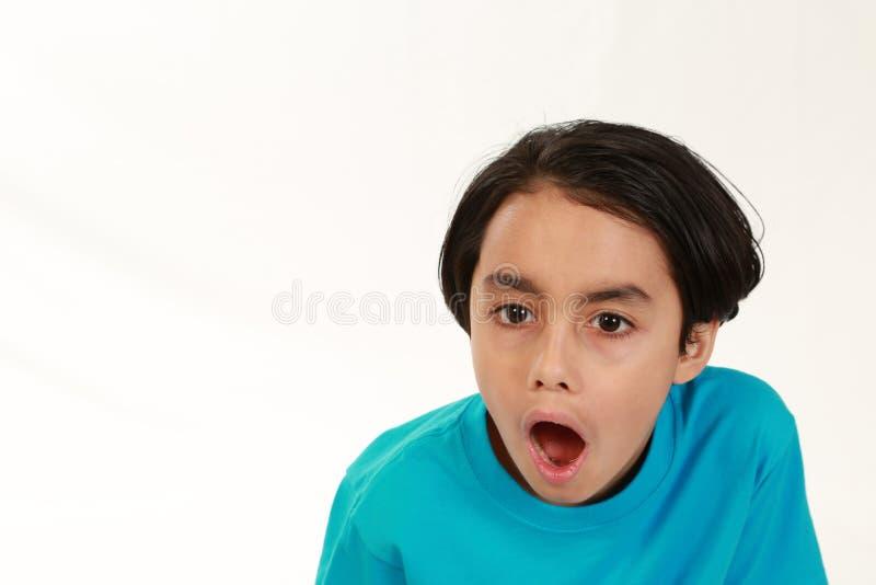 Menino da raça misturada Shocked foto de stock
