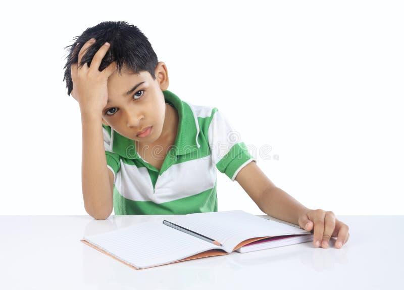Menino de escola deprimido imagem de stock