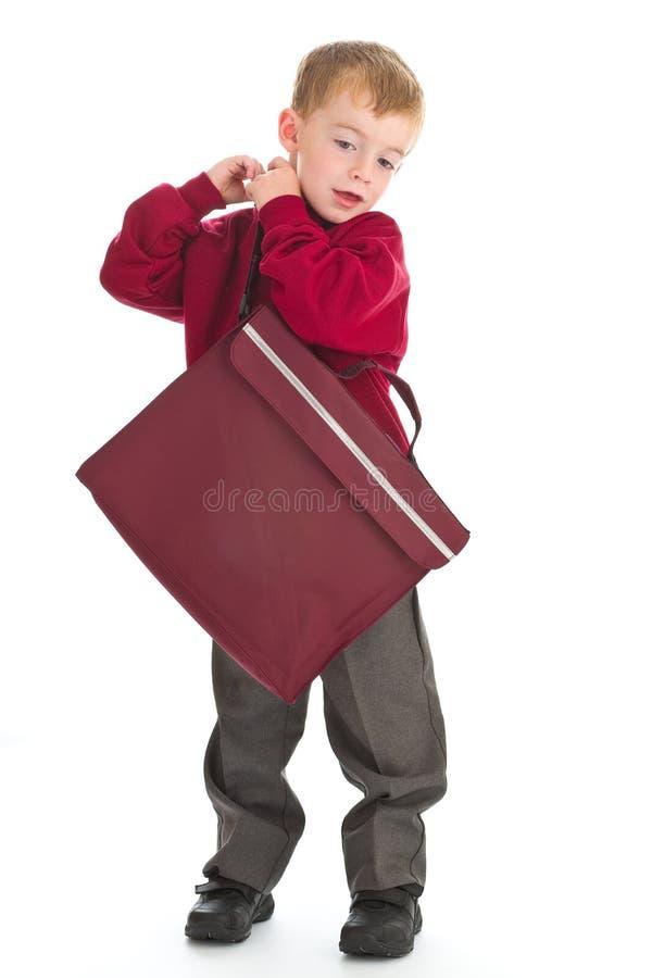 Menino de escola no uniforme imagens de stock royalty free