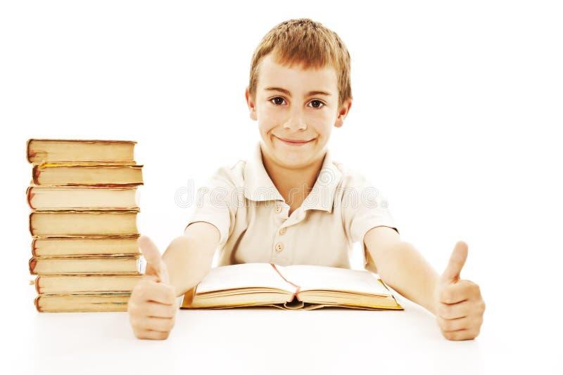 Menino de escola que mostra os polegares acima foto de stock