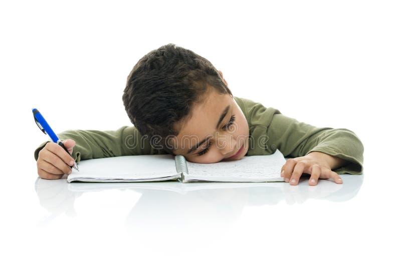 Menino de estudo novo cansado imagem de stock