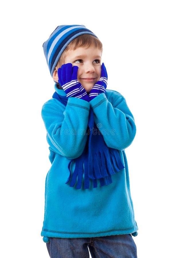 Menino de sonho na roupa do inverno imagens de stock
