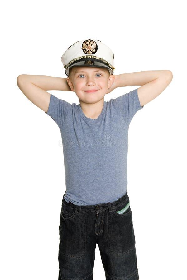 Menino de sorriso com os braços levantados fotos de stock royalty free