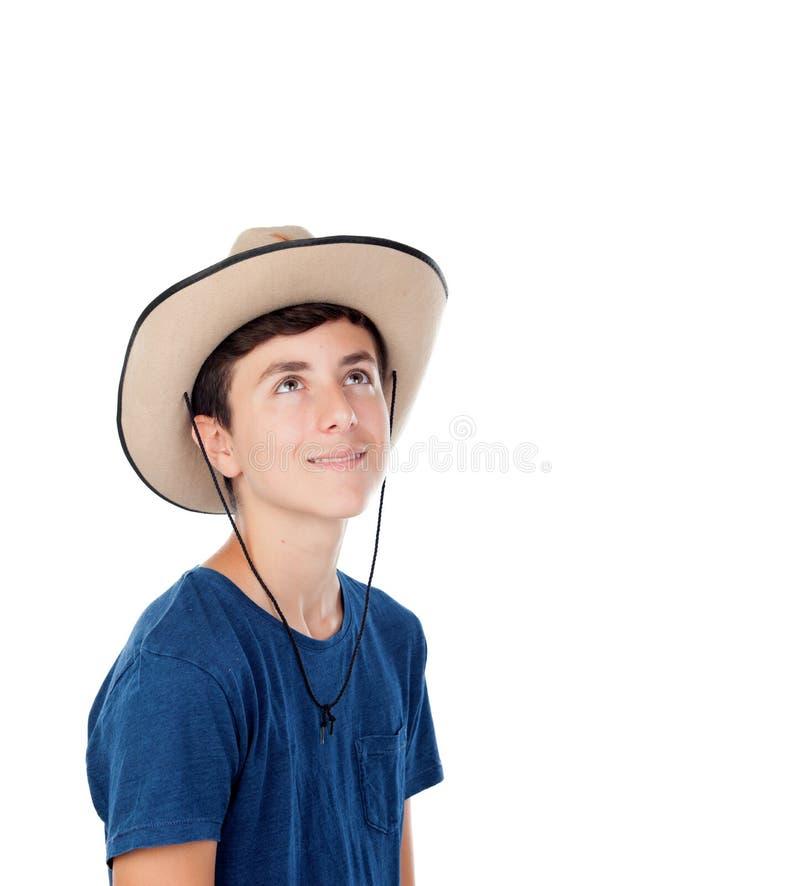 Menino do adolescente com um chapéu de vaqueiro fotografia de stock royalty free