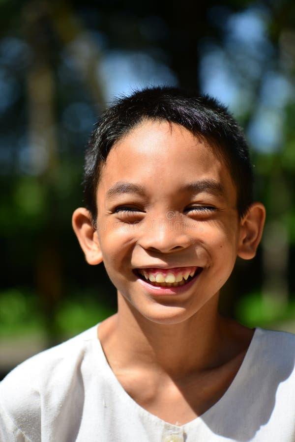 Menino do asiático do sorriso imagens de stock