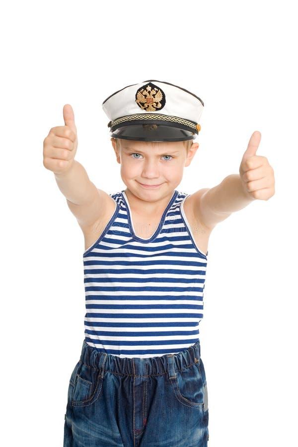 Menino do mar que mostra o gesto aprovado imagens de stock royalty free