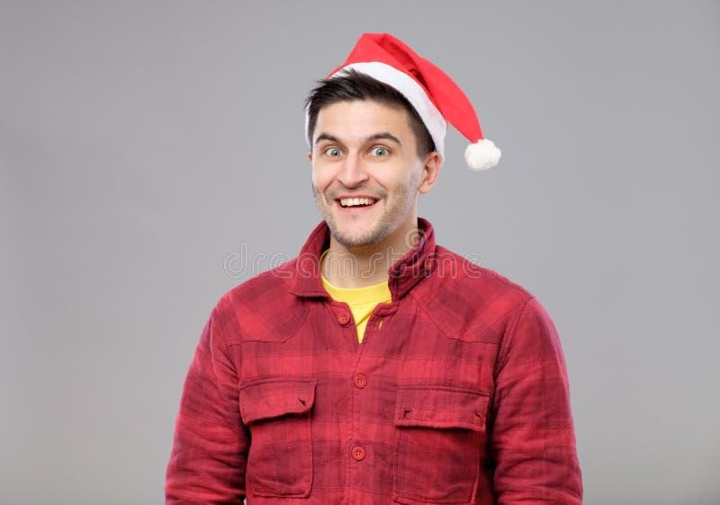 Menino do moderno no chapéu do Natal imagem de stock royalty free