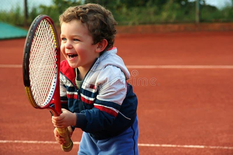 Menino do tênis imagem de stock