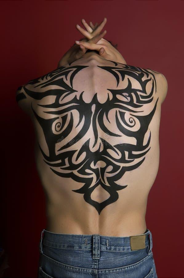 Menino do tatuagem imagem de stock
