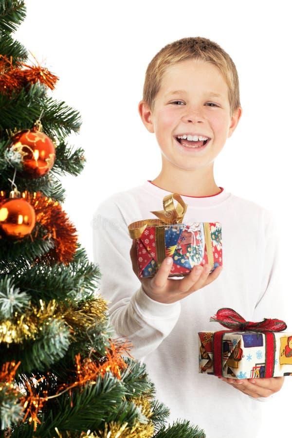 Menino e dois presentes de Natal imagem de stock