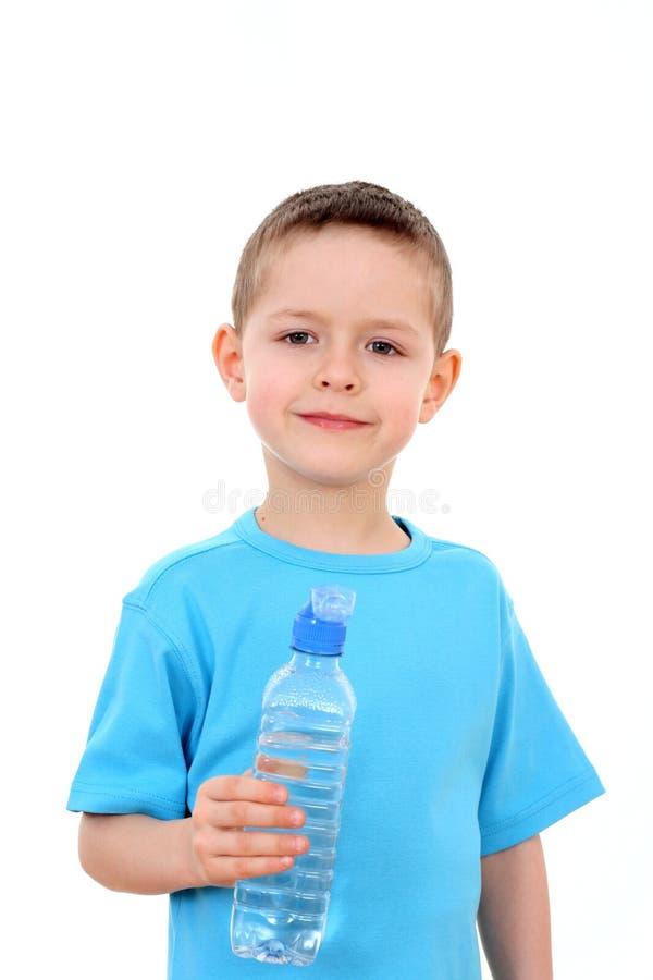 Menino e frasco da água imagem de stock royalty free