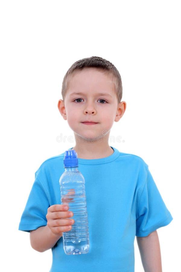 Menino e frasco da água foto de stock royalty free