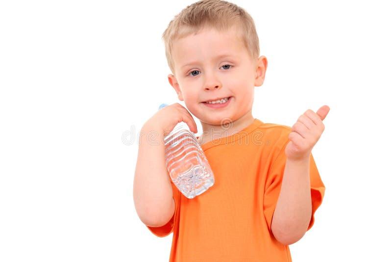 Menino e frasco da água fotos de stock
